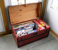 Old trunks make a great storage solution at cottages for games, blankets, just about anything you need to stash away.