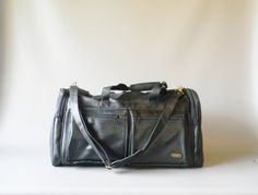 Vintage Black Leather Duffle Bag by DaisyFieldVintage on Etsy $50 Length: 22 inches Width: 11 inches Height: 12 inches