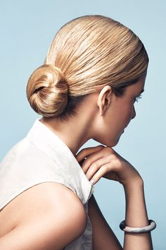 """Do the """"low-do."""" Perfect a slicked-back take on the always-classic chignon with LOCK IT Extreme Style Gel (perfect for blonde hair between washes)."""