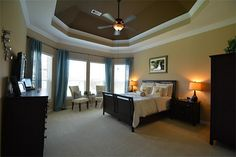 Master Bedroom has Sitting has Sitting Area, High Coffered Ceilings trimmed with Crown Molding, Accent Paint, and more!
