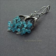 Beautiful blue with oxidized silver earring.