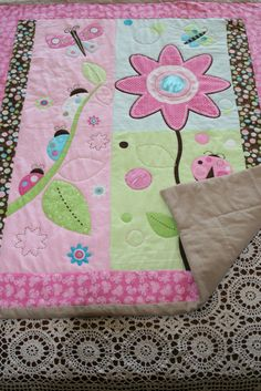 Get Ready for Spring Handmade Hand Quilted Baby Quilt Girls Throw Wall Hanging in Floral Butterfly Ladybugs and Vibrant Colors. $99.00, via Etsy.