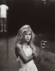 Sally Mann has used her 8 x 10 view camera to capture in fine detail, among other subjects, images of her children as they mimic and act out social and familial roles in the lush landscape of their rural Virginia home.