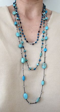 This turquoise necklace looks so pretty! Just one of our favorite ones. $12 https://www.etsy.com/listing/218525331/long-turquoise-black-stones-and-white