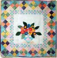Easter Basket Quilt Pattern. Easy piecing set on point and checkerboard borders in pastel shades add to the charm when you learn a new way to do dimensional applique flowers and leaves in this beautiful quilted wall hanging pattern. The pattern is a great choice for hand dyed fabrics, batiks or pastel cottons. http://www.kayewood.com/item/Easter_Basket_Quilt_Pattern/2530 $9.50