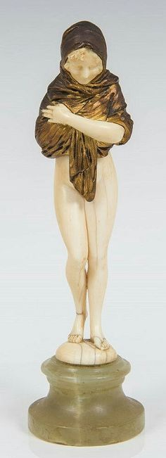 Dominique Alonzo, 1920s Art Deco French carved ivory and gilt bronze figure of an attractive semi-clad young woman, with a shawl wrapped around her head and shoulders, standing on a circular and sloped green onyx base, signed 'Alonzo' by left foot, 19cm high.