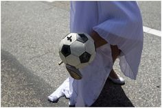 Bride playing soccer  | Photography © Vanessa Fry via French Wedding Style