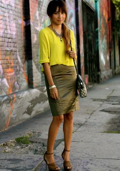 colors i wouldn't have put together with olive skin tone, but looks great. olive skirt and yellow tee-shirt.