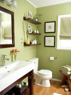 I love this color of green & the dark wood against the cool color... and the shelves above the commode, but that's where our window is... we have like NO wall space in our bathroom... it needs a redo for certain!