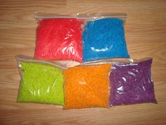 DIY colored rice. who would have thought 1 tsp of alcohol, food coloring and a cup of rice would make rice look like this!!!!! great for home made sensory toys too :)