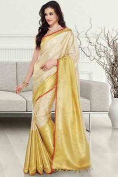 Pale gold & cream tissue brocade zari weaved saree in rust border