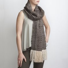 Hand Woven Brown Alpaca Scarf with Ripple Pattern. Hand woven to a complex rippling design inspired by the rapids on a river. This generously sized scarf is the ultimate luxury to drape around your neck.