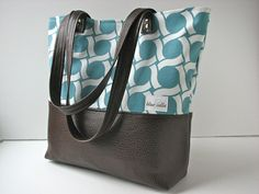 For all my vegan friends. Tote Bag/Shoulder Bag in turquoise circles with chocolate brown faux leather by BlueCalla, $62.00 I think this would go perfectly with my parka ;)