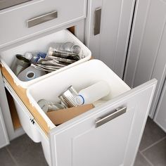 This pullout turns standard cabinet space into a trash and recycling center.