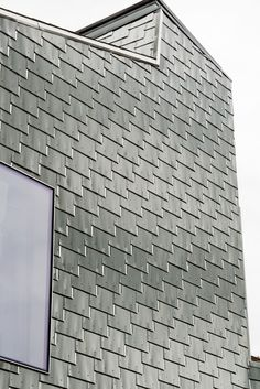 the stamped recycled aluminum shingles cost just two dollars per square foot—on par with run-of-the-mill vinyl siding - See more at: http://www.dwell.com/houses-we-love/article/traditional-shingle-clad-home-connecticut#2 Info on these shingles available on website. Click through