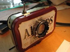 DIY Gadgets - DIY Film Projector That Fits In The Palm Of Your Hand - Homemade Gadget Ideas and Projects for Men, Women, Teens and Kids - Steampunk Inventions, How To Build Easy Electronics, Cool Spy Gear and Do It Yourself Tech Toys Diy Electronics, Electronics Projects, Cool Diy, Diys, Altoids Tins, Palm Of Your Hand, Cool Gadgets, Spy Gadgets, Tricks
