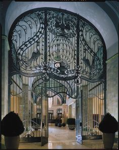 """Hungarian Art Nouveau"" at the Gresham Palace Budapest. Gresham Palace or Gresham-palota, located in Budapest, Hungary, is an example of Art Nouveau architecture in Central Europe. Built during the early 1900s, it is now a Four Seasons Hotel 