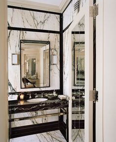 Strong gray veins on a clean white ground create a strong wall surface. The black painted moldings accent the architecture and frame the stone.