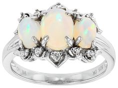 1.28ctw Oval Cabochon Ethiopian Opal With .09ctw Round White Zircon Sterling Silver 3-stone Ring