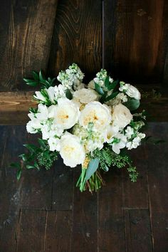 White English Garden Roses, White Ranunculus, White Stock, White Freesia, White Snowball Viburnum, Green Seeded Eucalyptus, Green Ruscus••••