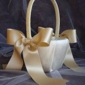 Flower girl basket with taupe ribbon. By Emici Bridal.