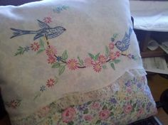Sweet toss pillow made from vintage hand-embroidered pillowcase. My own design.