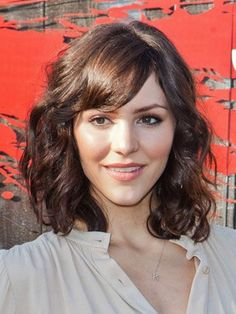 Shoulder Length Bob Haircut with Swept Bangs.  Medium Bob Hairstyle for women with curly hair and bangs.