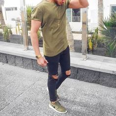 Plain Olive Tshirt styled with Black Ripped Jeans and a pair of Sneakers