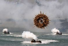 A mid-air explosion over a mock landing operation in Seoul, South Korea. | 30 Incredible Once In A Lifetime Shots
