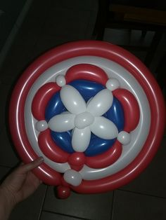 Captain America balloon shield. Created by Stephanie Lewis of Transformations Face Painting.