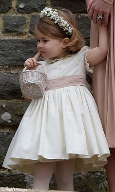Princess Charlotte at Pippa Middleton's wedding last May 2017 wearing a Peppa and Co bridgemaid dress. Princess Catherine often dresses Prince George and Princess Charlotte in this brand. Perfect flower girl dress for a family wedding. Kids Flower Girl Dresses, Wedding Dresses For Girls, Little Girl Dresses, Bridesmaid Dresses, Princesa Charlotte, Girls Special Occasion Dresses, Princess Kate, Dress And Heels, Silk Dress