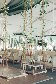 hang some whimsical wooden swings in the reception area and decorate them with greenery