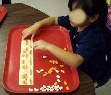sequencing using lima beans  paint half orange and add jack o lantern face  leave half white and add ghost face