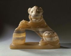 Banded Egyptian alabaster lion holding a vessel. Late Period. 27th dynasty. 525-404 B.C.E. | Brooklyn Museum