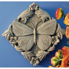 This butterfly surrounded by flowers evokes a sense of peace and a connection with nature. Made in U.S.A.