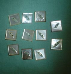Set of square mother of pearl buttons. Sold in May 2011