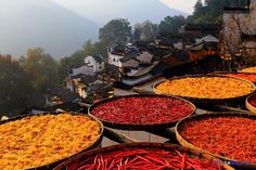 Chilli peppers, corn, chrysanthemums and other colourful crops sun drying in the ancient village in Wuyuan County, Jiangxi Province.