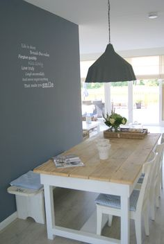 In Love! Fantastic way to work a small dining space.
