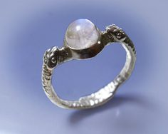 Silver snake ring with adularescent moonstone by WildBeautyDesign