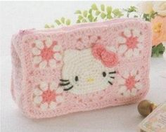 Child's Hello Kitty bag. I found this on a French site which shows dozens of beautiful crochet patterns. This one is actually in Russian, so I can't read the article, but I love this design!