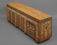 Coffin of Khnumnakht(Dynasty 13,Middle Kingdom) : The brilliantly painted exterior of the coffin of Khnumnakht, an individual unknown except for his name, displays the multiplicity of texts and decorative panels characteristic of coffin decoration in the late Middle Kingdom. ...click picture to read more...