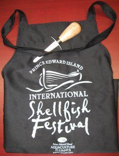 How often do you cook #Shellfish?! This #gift #pack includes a #PEI Shellfish #Festival #Apron and #Oyster #Shucking #Knife! Great for all the prep in the kitchen this Holiday Season and for only $25! — at 101 Longworth Avenue, Charlottetown PE, C1A 5A9.