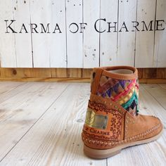 Soft leather boots, in cognac color, with little silver studs and a unique ethnic texture in calf hair hand-stitched. The unique decorated metal plate, placed on a leather base bearing the inscription Karma of Charme, verifies the originality.  #boho #shoes #ethnic #boots #hippiechic