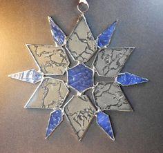 Snowflake. Holiday ornament. Suncatcher. Light Blue Star.