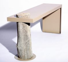 Table CAMELEON  Functional table design.  Cameleon offers precisely what you expect of a table of that name: it takes on the form that best fits its environment. Besides the dimensions, you define the color of the powder coated steel tablet. Unique driftwood support.  More info: www.conceptsbycatherine.be