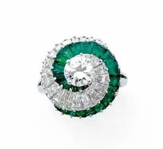 A DIAMOND, EMERALD AND PLATINUM RING, BY CARTIER