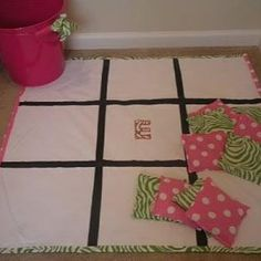 Fabric & paint tic-tac-toe game. Minus the girly colors. Maybe superhero fabric? Swell kid gift.