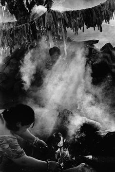 Abbas 2001 Siberia. Tuva. Kyzyl. Shaman Luda uses smoke from a juniper twig to cleanse a patient of evil spirits. She operates by the ovaa (altar) of the Tos Deer Shaman association