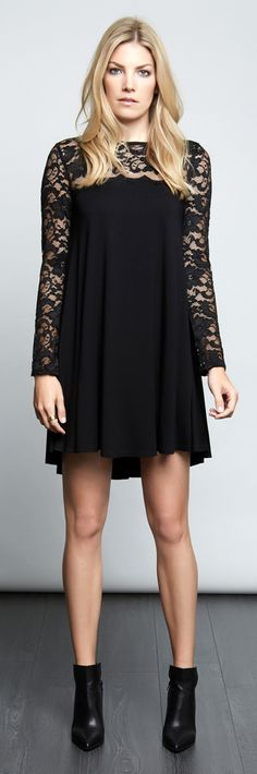 Sheer floral lace adds evening elegance to a stretchy swing dress in comfortable jersey-knit fabric.