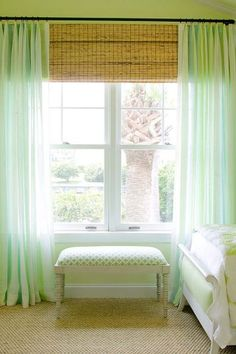 hang bamboo shades right under the curtain rod to make the window appear larger